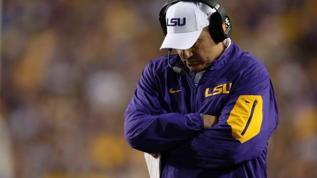 Beloved but stubborn, Les Miles lost his job because he didn't evolve while LSU's rivals did; Punt, Pass & Pork