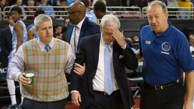 North Carolina head coach Roy Williams collapses during timeout--IMAGE