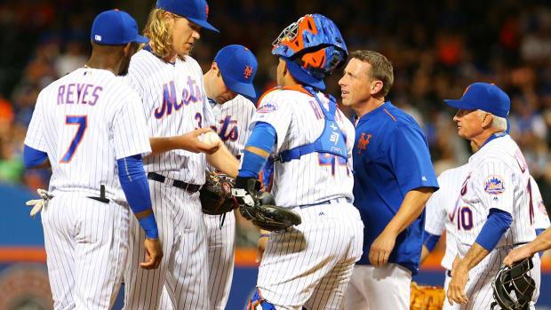 Mets' Yoenis Cespedes, Noah Syndergaard leave game with injuries -- IMAGE