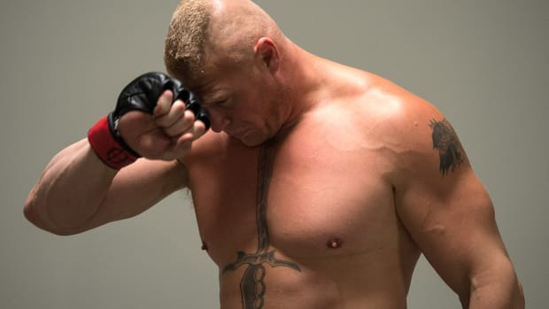 Brock Lesnar hand on face