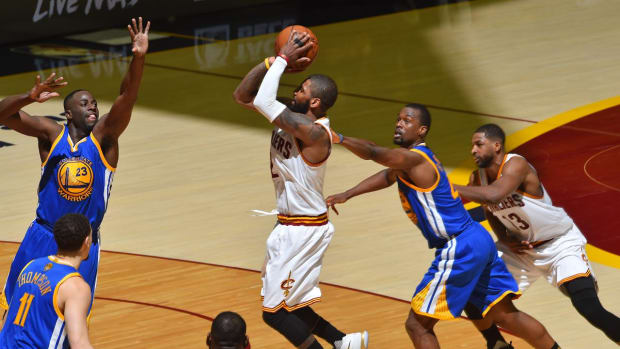 LeBron James points to solid defense as key to playoff victories--IMAGE