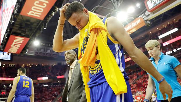stephen-curry-knee-injury-warriors-rockets-game-4-nba-playoffs.jpg