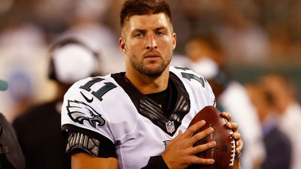 tim-tebow-football-baseball.jpg