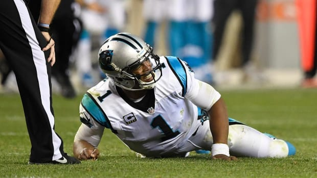 Cam Newton says he tries 'to warn refs' about helmet hits -- IMAGE