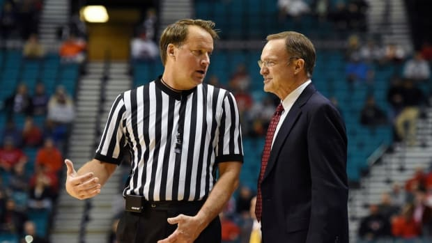Up in the Air: John Higgins is one of the nation's most visible, wanted—and loathed—basketball referees