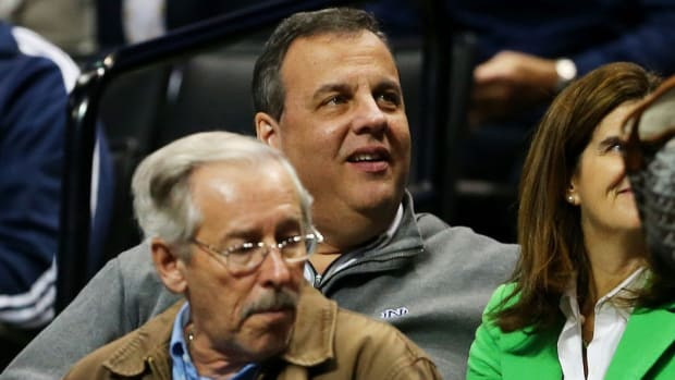 Chris Christie pours small bag of M&Ms into big bag of M&Ms, probably helps Notre Dame win