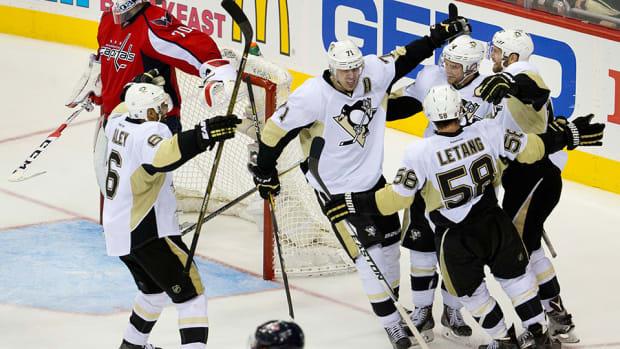 penguins-top-capitals-game-2-brooks-orpik-hit-olli-matta-nhl-960.jpg