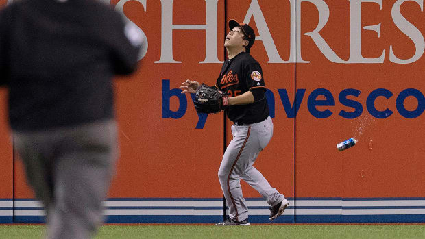 fan-throws-beer-can-at-orioles-kim.jpg