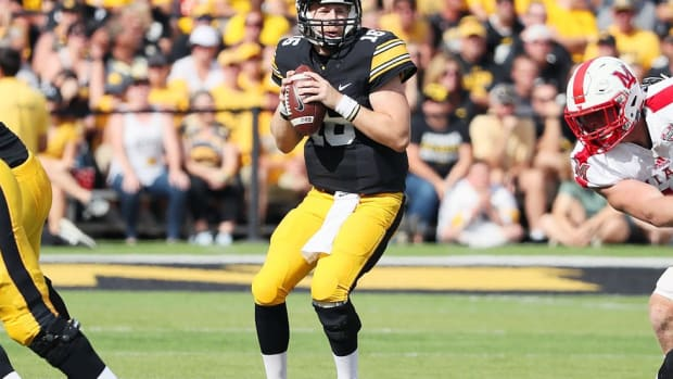 Raised on football and country music, quarterback C.J. Beathard striking a chord at Iowa
