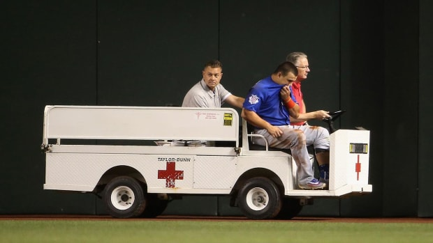 Cubs' Kyle Schwarber carted off after outfield collision--IMAGE