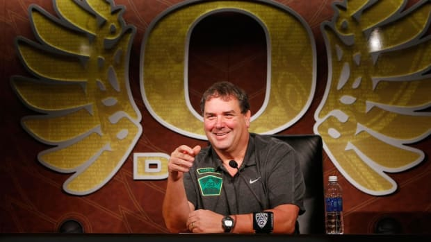With a friend nearby and a big job ahead, Brady Hoke is ready to fix an Oregon defense in serious need of repair