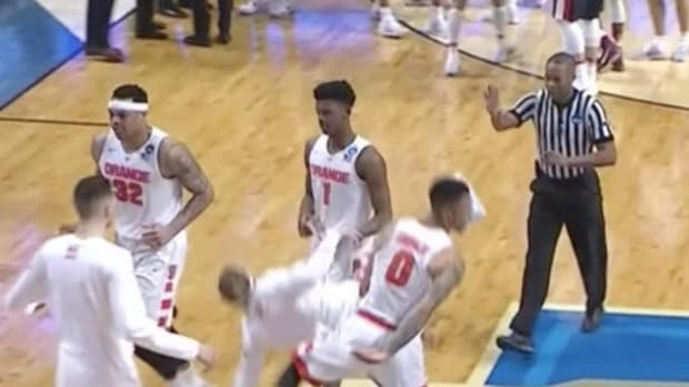 Poor Syracuse walk-on gets knocked to the floor on a shoulder bump