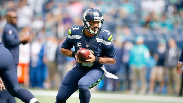 Report: Russell Wilson will play Sunday vs. Rams despite high ankle sprain IMAGE