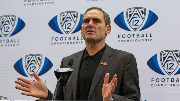 Problems in the Pac-12? Larry Scott faces league issues that go beyond satellite camp vote; Punt, Pass & Pork