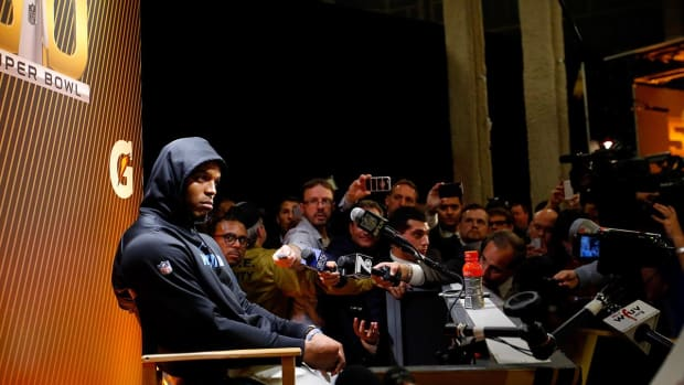 Cam Newton walks out of press conference-IMAGE