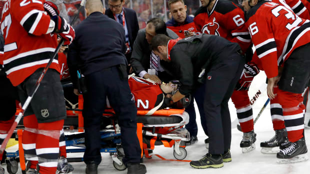 devils-john-moore-tom-wilson-hit-stretcher-video.jpg