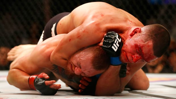ufc-196-nate-diaz-beats-conor-mcgregor-miesha-tate-defeats-holly-holm.jpg