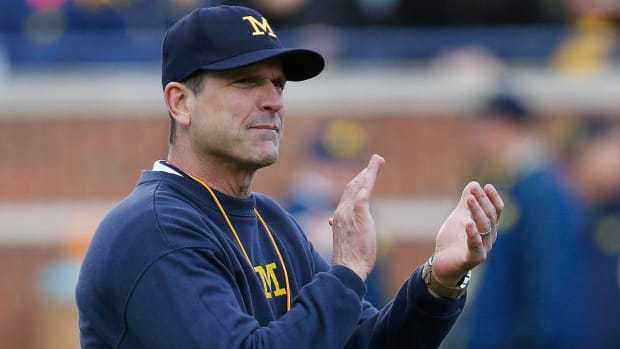 Jim Harbaugh goes around the world to develop players -- IMAGE