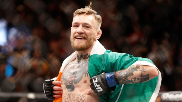 ufc-197-conor-mcgregor-holly-holm.jpg