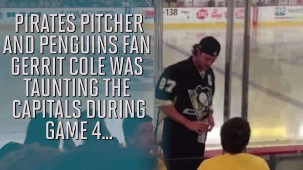 Gerrit Cole told to stop banging on glass at Penguins game--IMAGE