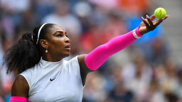 Serena Williams passes Roger Federer for major match wins record -- IMAGE