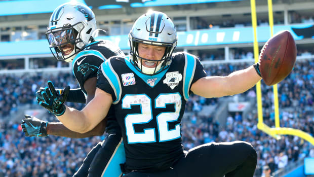 Nov 3, 2019; Charlotte, NC, USA; Carolina Panthers running back Christian McCaffrey (22) celebrates a touchdown with wide receiver Jarius Wright (13) in the second quarter at Bank of America Stadium. Mandatory Credit: Jeremy Brevard-USA TODAY Sports