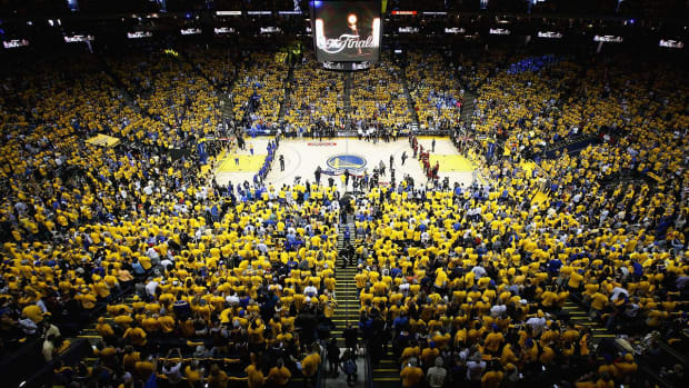 Fan falls from deck after NBA Finals Game 7 - IMAGE