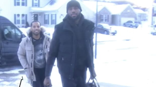 lebron-james-delivers-prize-money-the-wall.jpg