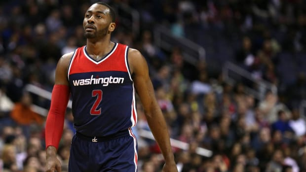 John Wall responds to critics: 'Stop saying I'm watching the money'--IMAGE