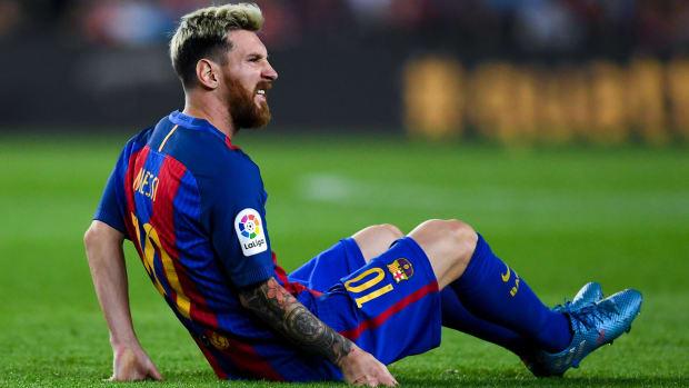 messi-barcelona-groin-injury.jpg