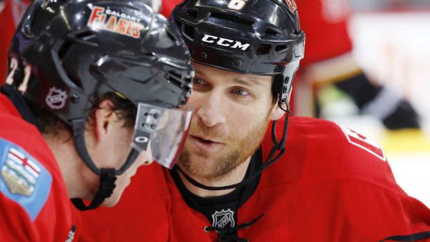 Dennis-Wideman-Gerry-Thomas-NHLI.jpg