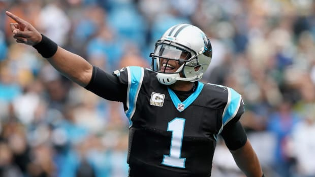 Watch: Cam Newton hops fence to play football with seventh-graders -- IMAGE