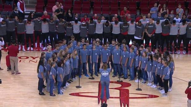 Knicks, Rockets stand together during national anthem - IMAGE