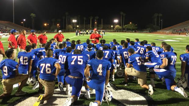 brownsville-football-team-kneeling_0.jpg