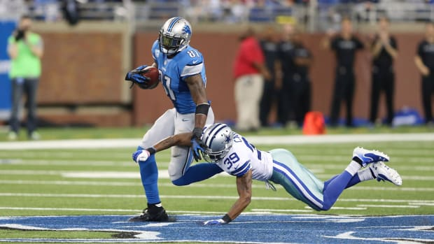 calvin-johnson-lions-retires-200-yard-games.jpg