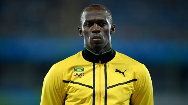 usain-bolt-jamaica-relay-gold-medal.jpg
