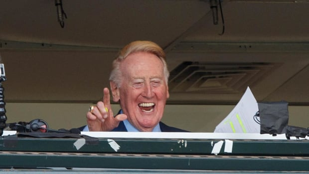 Vin Scully signs off for final time - IMAGE