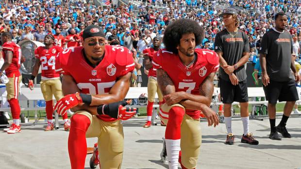 Eric Reid kneeling alongside Colin Kaepernick