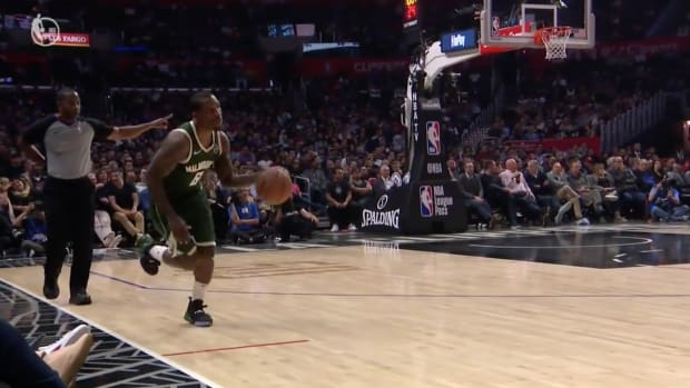 Eric Bledsoe dribbles the ball in bounds
