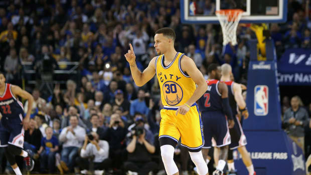 stephen-curry-warriors-improve-record.jpg