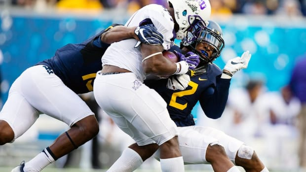 'I get on their asses if they give up a yard': The secret to West Virginia's defensive success in high-scoring Big 12