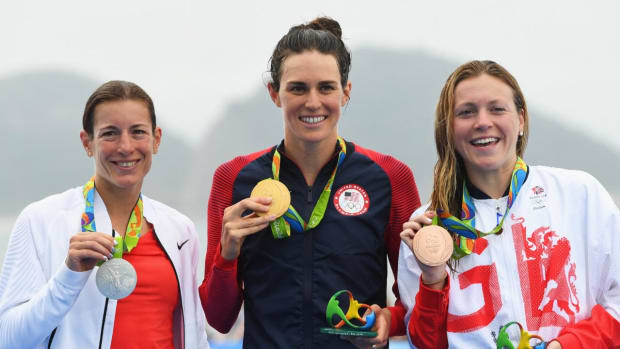 Jorgensen wins gold in triathlon, Stevenson wins silver in bantamweight boxing--IMAGE
