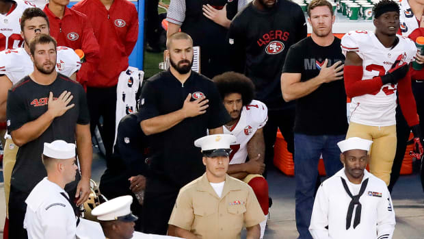 49ers-colin-kaepernick-eric-reid-kneel-national-anthem.jpg