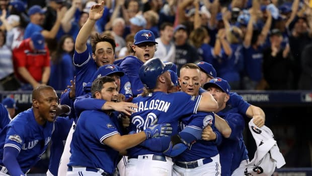Blue Jays walk off on Rougned Odor's throwing error, advance to ALCS - IMAGE