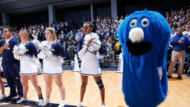 Whether he's licking fans with a two-foot tongue or swallowing jackets, Xavier's Blue Blob is hard to miss