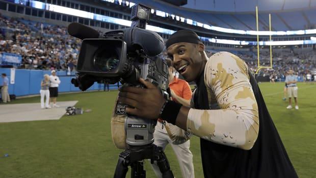 cam-newton-tv-camera-media-circus-fans-sports-broadcasting.jpg