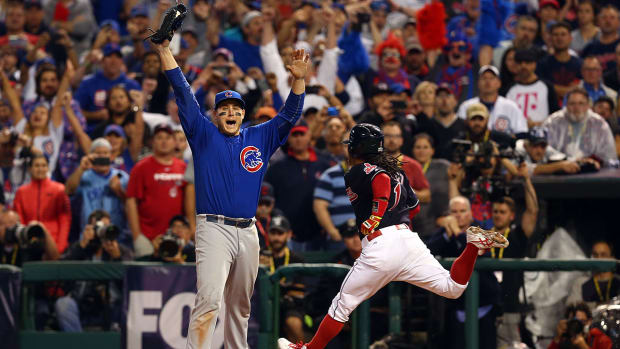 anthony-rizzo-gives-final-out-ball-tom-ricketts.jpg