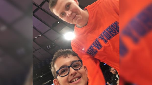 Crying Knicks fan from NBA Draft meets Kristaps Porzingis and family IMG