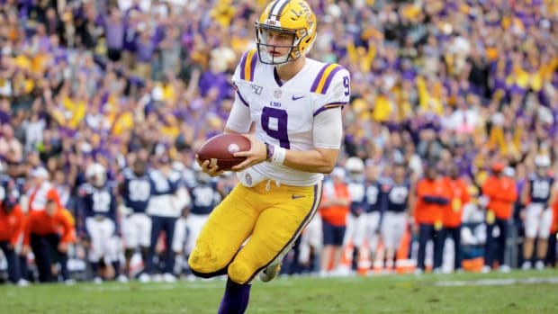 Oct 26, 2019; Baton Rouge, LA, USA; LSU Tigers quarterback Joe Burrow (9) runs for a touchdown during the fourth quarter against the Auburn Tigers at Tiger Stadium. Mandatory Credit: Derick E. Hingle-USA TODAY Sports