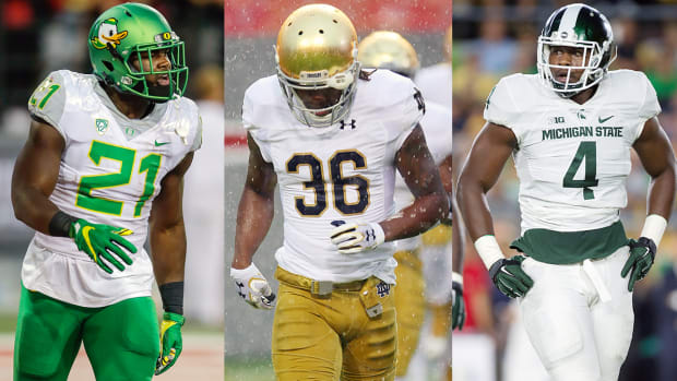 royce-freeman-cole-luke-malik-mcdowell-oregon-notre-dame-michigan-state-football-flop.jpg